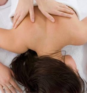 Pampered young woman with male hands doing a massage